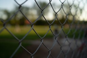 A chainlink fence with blurred background
