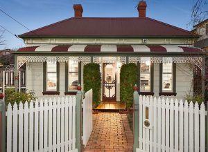 Picket fence at the front of a house