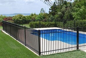 Steel fence around a swimming pool