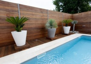 A timber fence next to a swimming pool